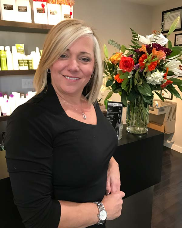 Sharon posing at the front desk of Dominic Ricci Salon